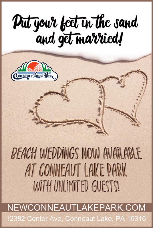 Beach Wedding ad with hearts drawn in the sand